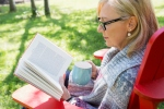 Picture of woman reading book and drinking coffee